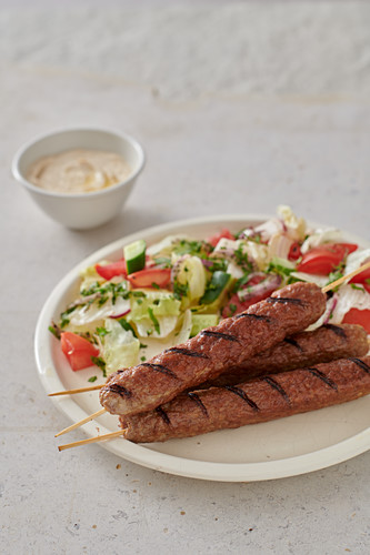 Grilled lamb skewers with salad