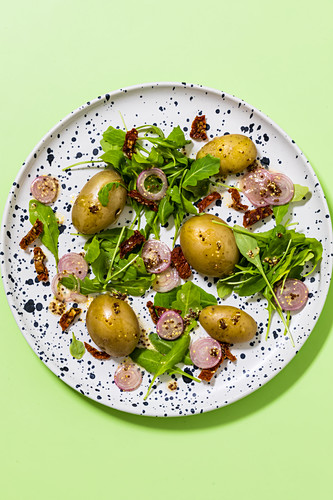 New potato salad with dried tomatoes and rocket