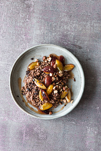 Gluten-free buckwheat and cocoa porridge with nuts and plums
