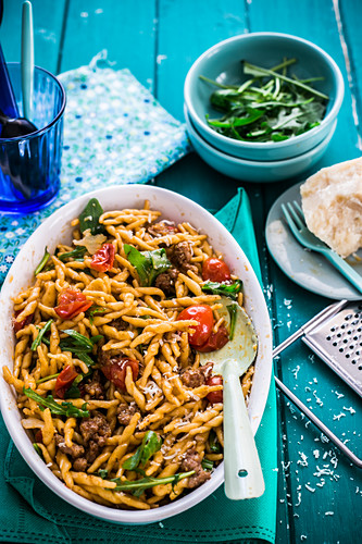 Strozzapreti with rocket, sausage and cherry tomatoes