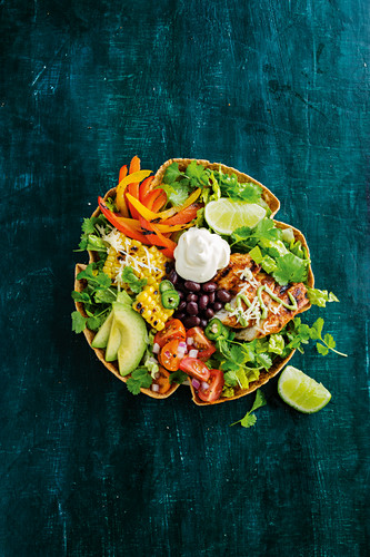 Taco salad bowl with chicken and green goddess dressing