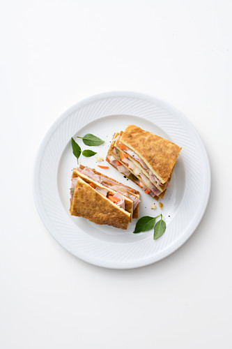 An omelette sandwich with ham and cheese