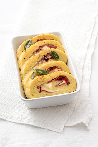 Potato roulade with bacon, sage and cheese