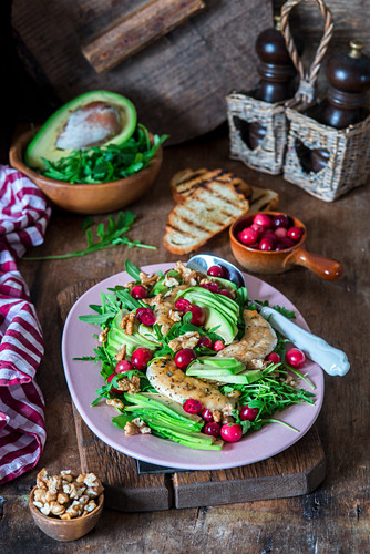 Salad with chicken breast, avocado, cranberries and walnuts
