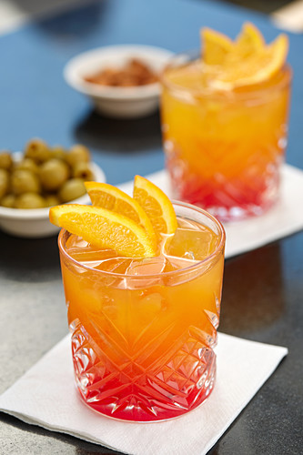 An aperitif with Campari soda, olives and almonds