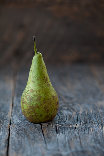 A Williams pear on a rustic background