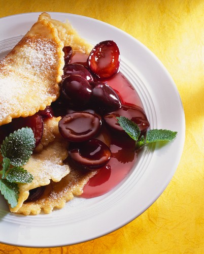 Pancake with damson sauce