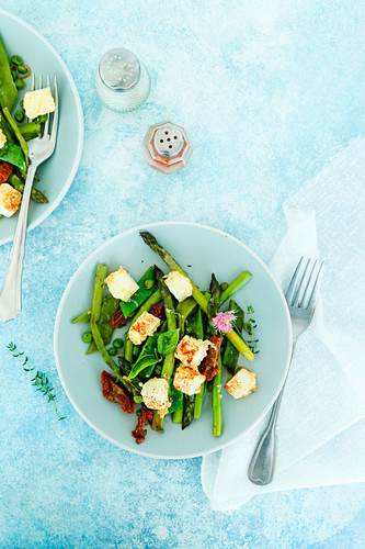 Asparagus salad peas flat beans thyme chives sun-dried tomatoes and paprika feta cheese