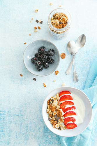 Breakfast with yogurt granola strawberries and blackberries