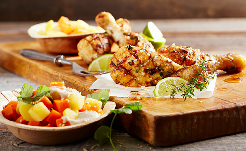 Grilled chicken legs marinated with a Caribbean spice mixture and sweet potato salad