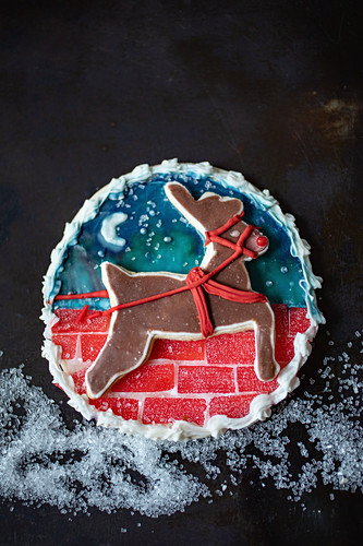 An artistically decorated Christmas biscuit with a reindeer