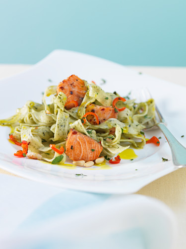 Herb tagliatelle with salmon, chilli and pine nuts