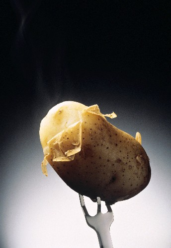 A Potato in its Skin on a Fork