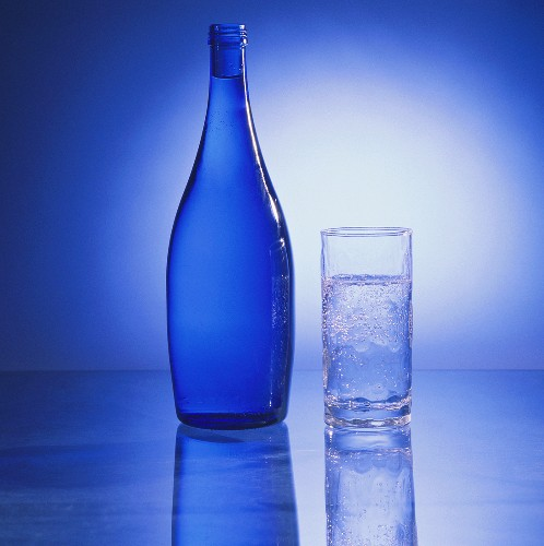 Glass of Mineral Water with Blue Bottle