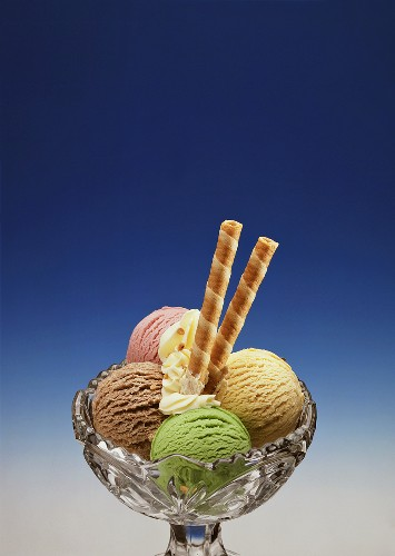 Four Assorted Scoops of Ice Cream in a Bowl; Cookies