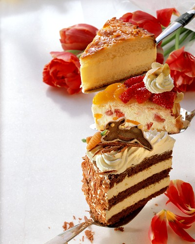 Three different pieces of gateau on cake slices