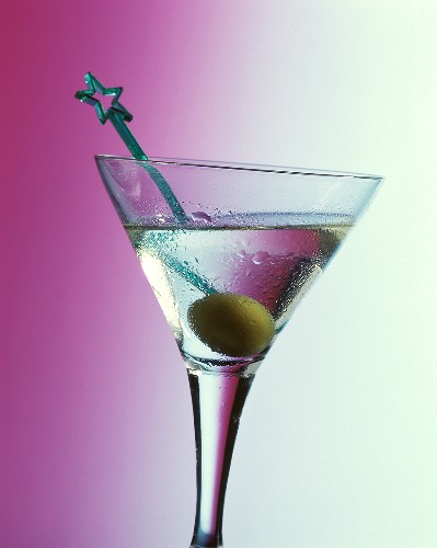 A Martini cocktail in aperitif glass with olive