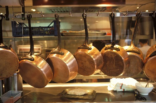 Copper Pans Hanging from Rack