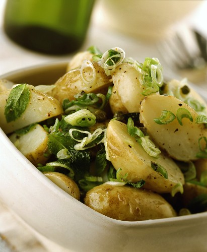 Potatoes in their skins with spring onions and cabbage