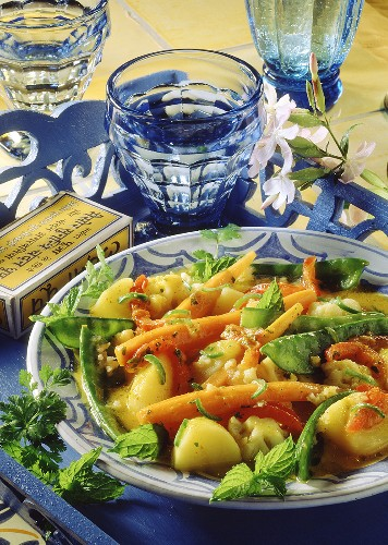 Indian potato stew with carrots and mangetouts