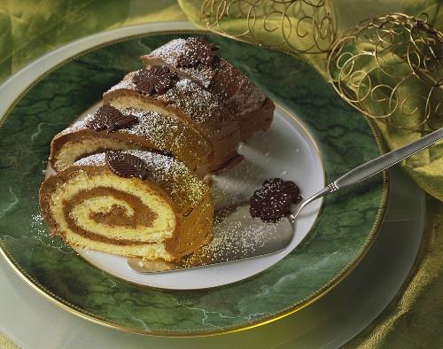 Buche de Noel, sliced, cake slice beside it