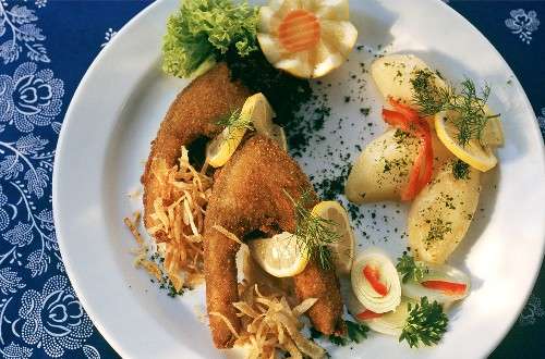 Baked carp with potatoes