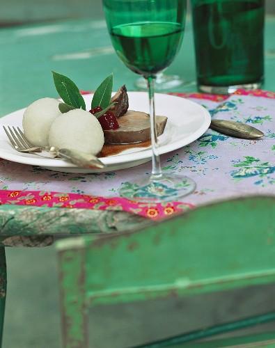 Leg of venison with potato dumplings & a glass of wine