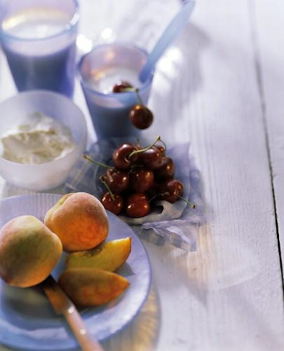 Fruit still life with peaches, cherries, quark & yoghurt