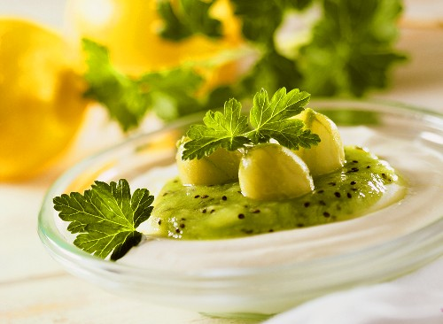 Ricotta mousse with kiwi fruit puree and gooseberries