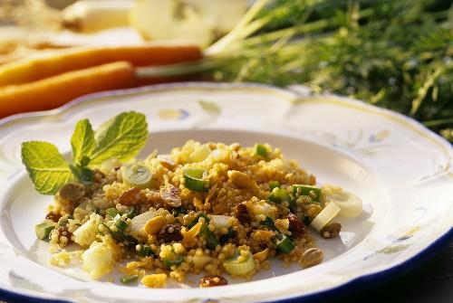 Tasty quinoa salad with fruit, raisins and mint