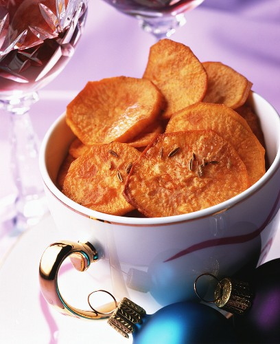 Deep-fried sweet potato slices with caraway