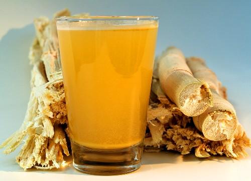 Glass of sugar cane juice (Garapa) and sugar cane fibres