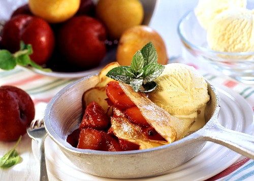 Crepe with caramelised plums and vanilla ice cream