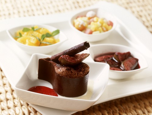 Tear-drop shaped chocolate cream with figs in port wine