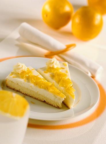Two pieces of orange cream sponge gateau