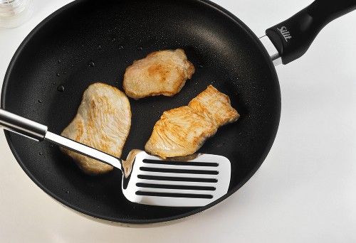 Frying escalope in a frying pan