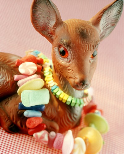 Toy deer and chains of sweets as gift or table decoration