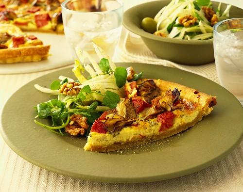 A piece of artichoke & mortadella quiche with salad garnish