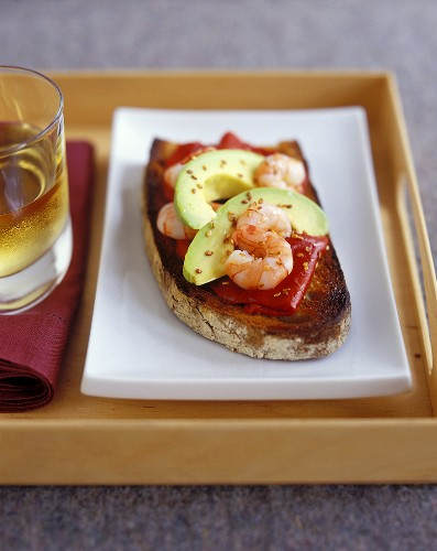 Toasted farmhouse bread with pepper, avocado and shrimps