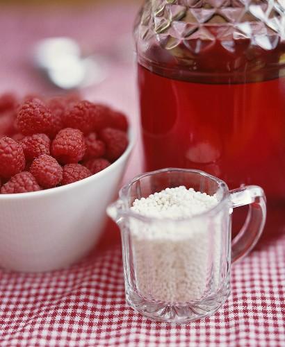 Ingredients for red berry compote (juice, barley, raspberries)
