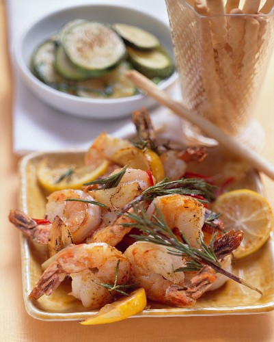 Shrimps fried in garlic oil and marinated courgettes