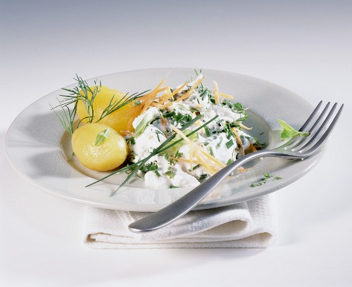 Boiled potatoes with carrot and herb quark