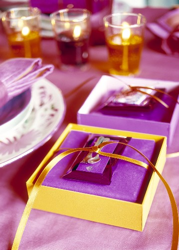 Christmas table decoration in purple and yellow