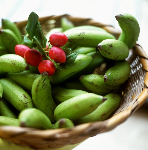 Green bananas and red almond fruits