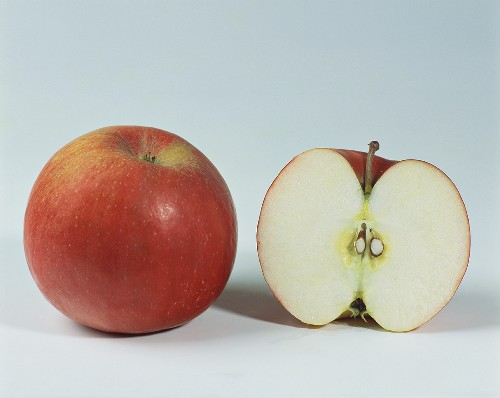 One half and one whole Idared apple