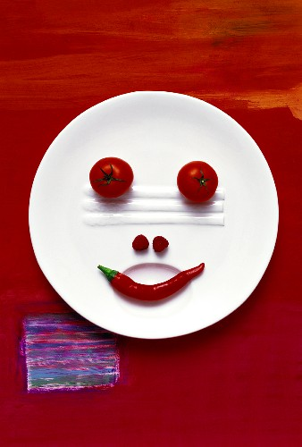 Food collage 'Vegetable face on plate'
