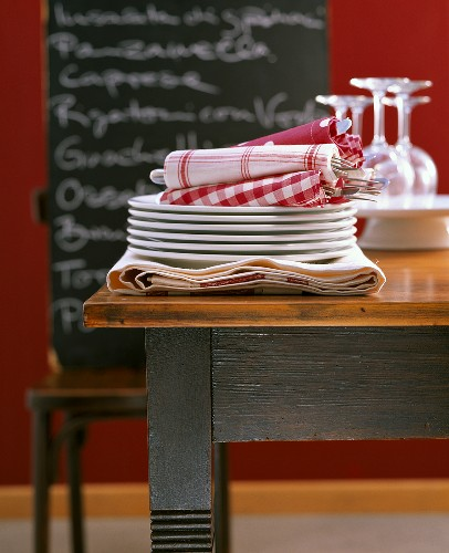 Table linen: fabric napkins on a pile of plates