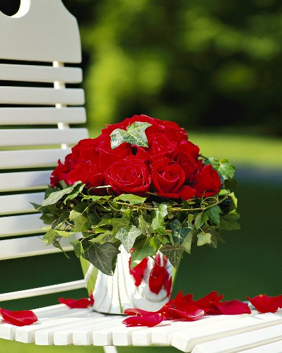 Red roses entwined by ivy