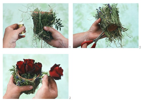 Arranging roses in terracotta pot with twigs