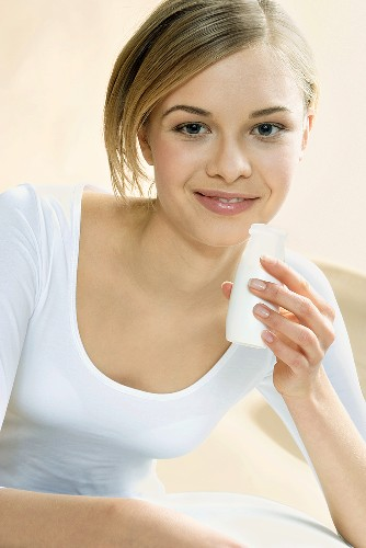 Young woman with probiotic yoghurt drink